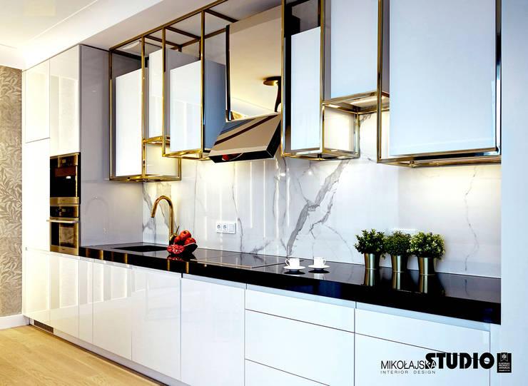 Built-in kitchens by MIKOŁAJSKAstudio , Eclectic