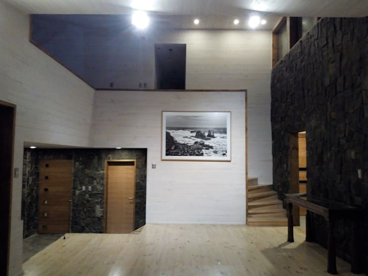 by Kimche Arquitectos Modern Wood Wood effect