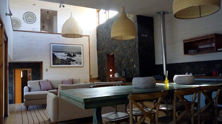 Modern Dining Room by Kimche Arquitectos Modern Stone