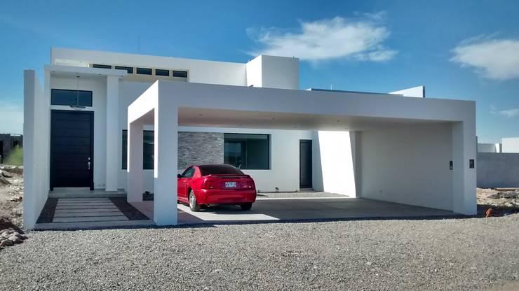Tabasco VI:  de estilo  por Guiza Construcciones