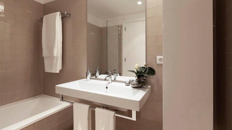 Acessórios que personalizam a sua casa de banho: Casa de banho  por Padimat Design+Technic