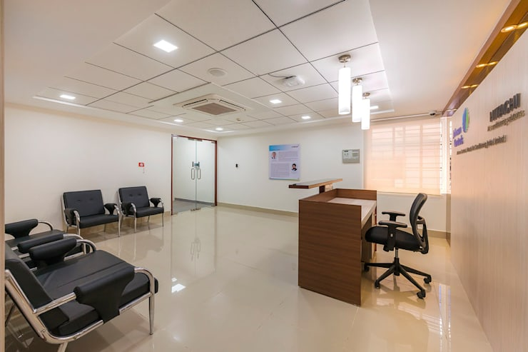 Interior for Reception Area:  Office spaces & stores  by Elcon Infrastructure