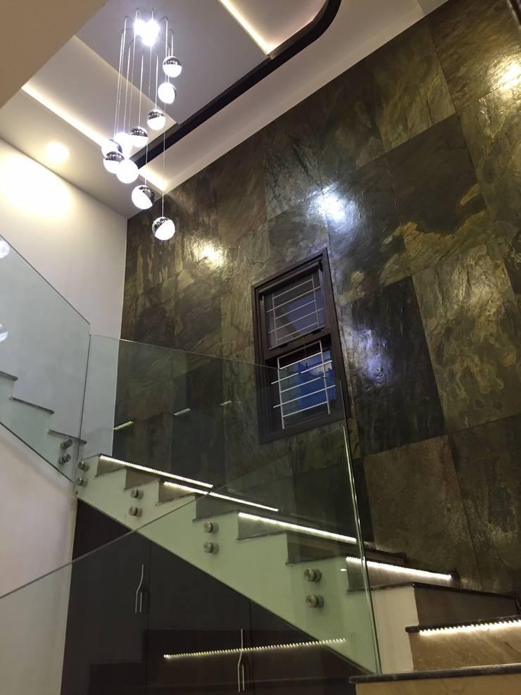 PLUSH & LAVISH VILLA:  Stairs by Vdezin Interiors,