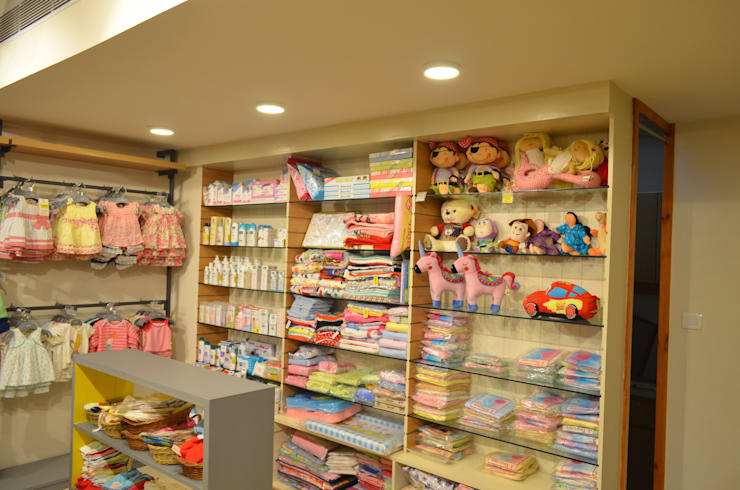 Kids Apparel Store:  Shopping Centres by Vdezin Interiors,