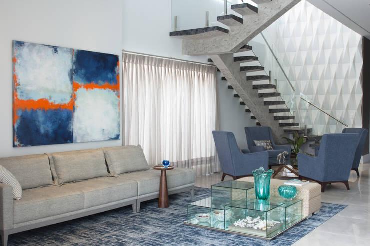 Living : Salas de estar modernas por Erlon Tessari Arquitetura e Design de Interiores