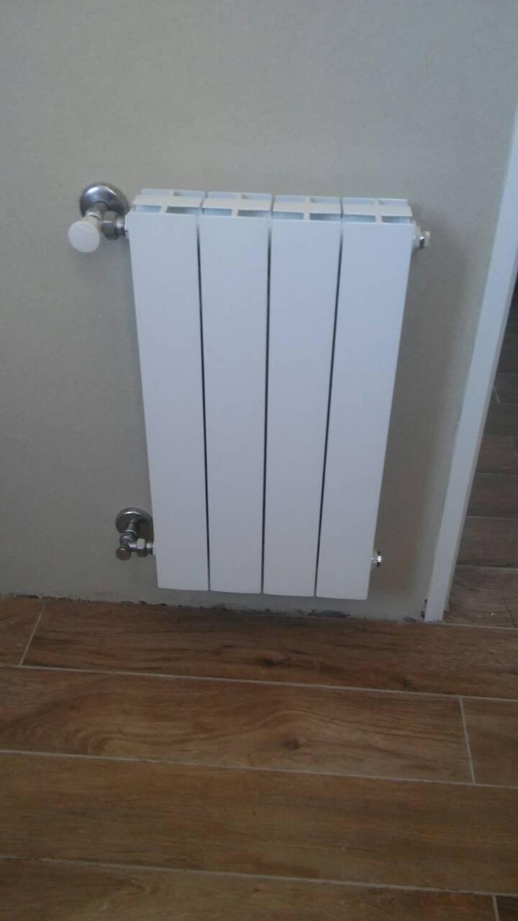 Radiadores y Toalleros:  de estilo  por INSERT. Calefacción y Energías Renovables,