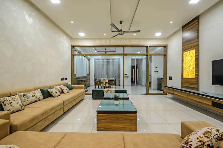 THE GREY HOUSE:  Living room by Maulik Vyas Architects,Modern Engineered Wood Transparent