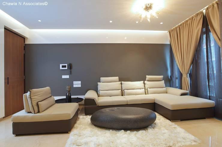 Dr.Bhavisha's Residence - Modern full interior renovation: modern Living room by Chawla N Associates