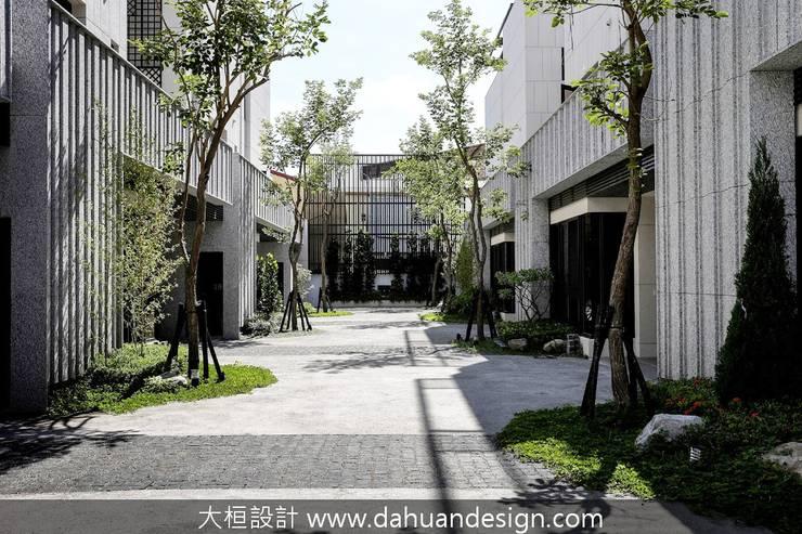 喬灌木畫出公私領域的分界:  別墅 by 大桓設計顧問有限公司