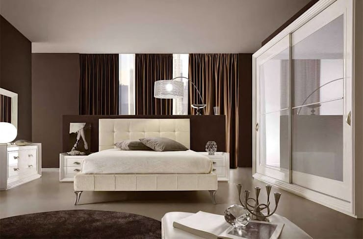 Lo stile classico in camera da letto: Camera da letto in stile  di Ferrari Arredo & Design