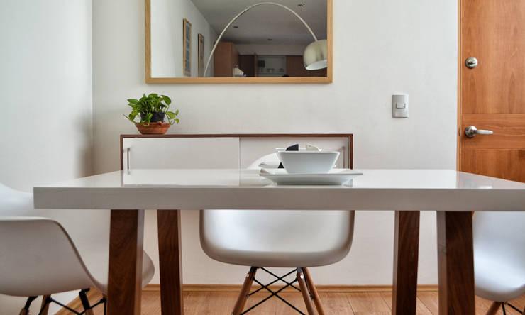 Comedor con diseño: Comedores de estilo minimalista por Estudio Raya