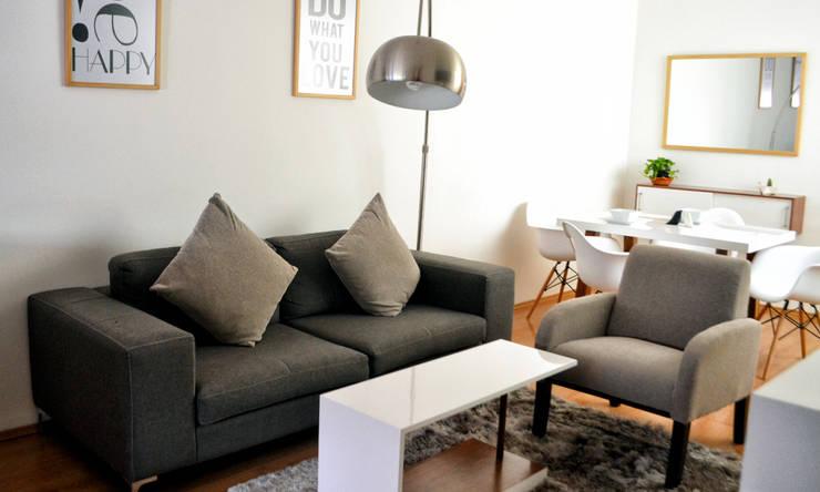 Sala acogedora: Salas de estilo minimalista por Estudio Raya