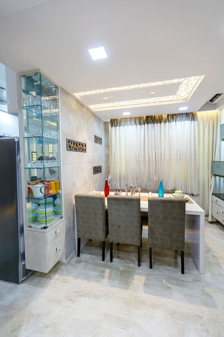 GB Road, Thane:  Dining room by aasha interiors,Modern