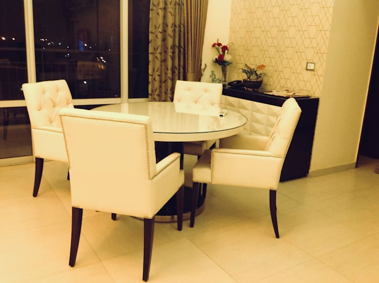 Residence @ Ireo Uptown Gurgaon:  Dining room by INTROSPECS,Modern