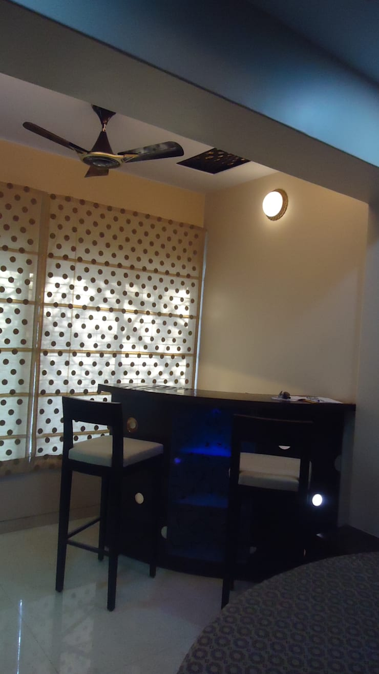 Thane:  Media room by aasha interiors,Modern