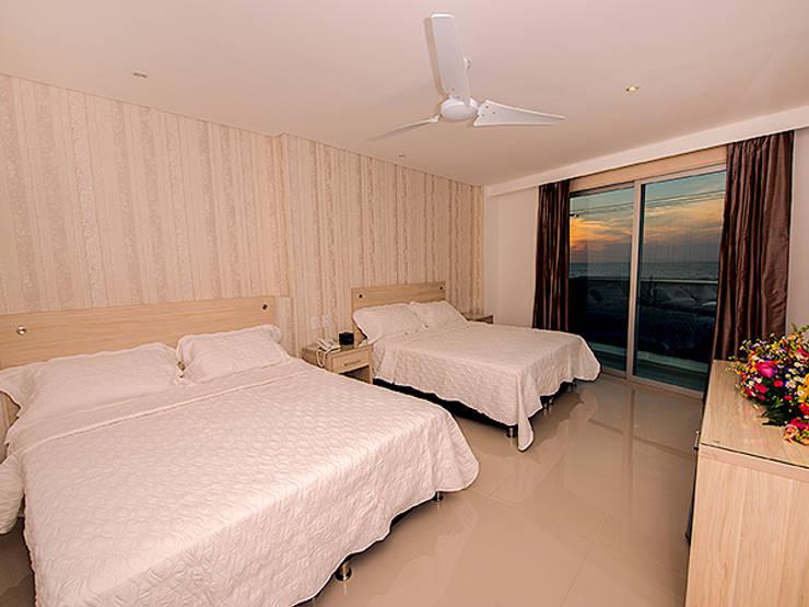 hotel summers: Habitaciones de estilo moderno por construcciones y soluciones integrales s.a.s