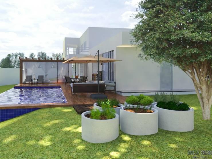 Horta: Jardins de fachadas de casas  por Daniela Ponsoni Arquitetura