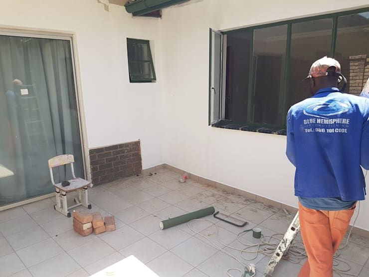 Room addition to existing home in Shere Pretoria East:   by PTA Builders And Renovators