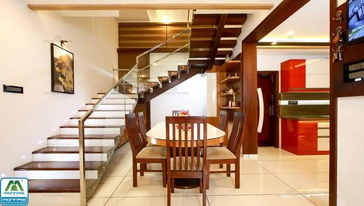 Ultra-Modern Designs:  Dining room by Premdas Krishna