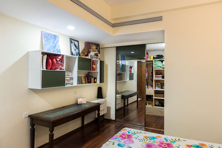 Anna varghese:  Living room by Designasm Studio
