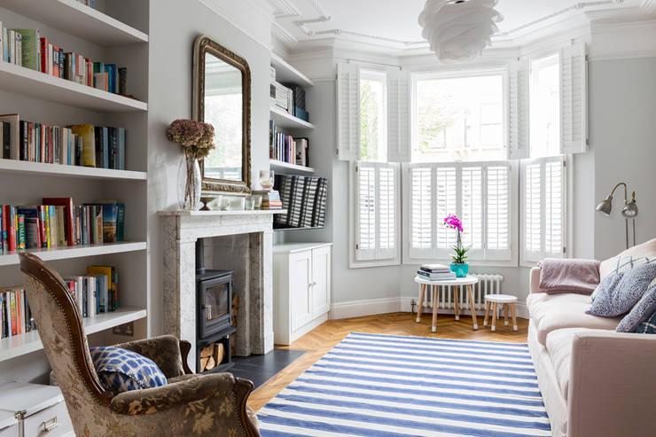North West London Terraced House:  Living room by VORBILD Architecture Ltd.
