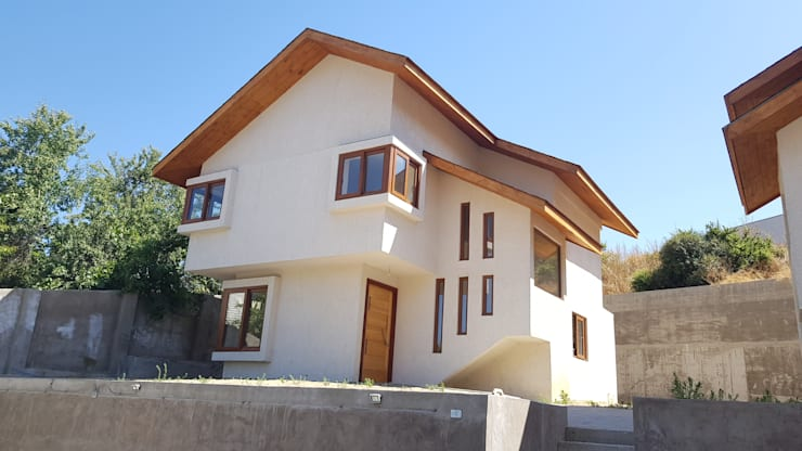 La vivienda busca las vistas y la luz : Casas unifamiliares de estilo  por Andes Arquitectura & Construcción