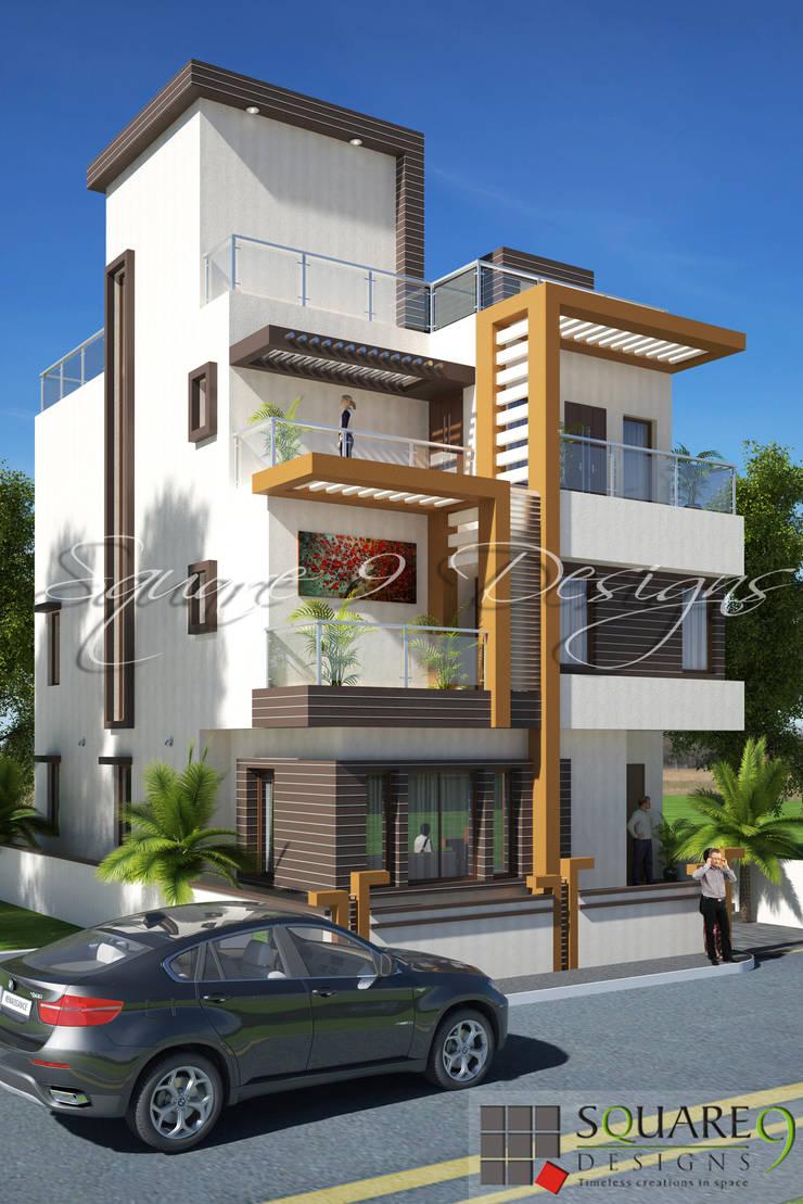 TARIQ KAMAL BUNGALOW :  Houses by Square 9 Designs