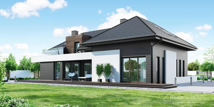 Casas unifamiliares de estilo  por HomeKONCEPT | Projekty Domów Nowoczesnych, Moderno