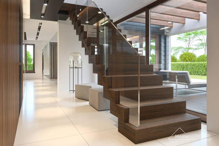 Escaleras de estilo  por HomeKONCEPT | Projekty Domów Nowoczesnych, Moderno