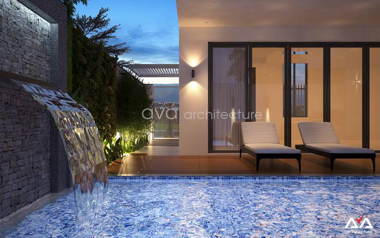 Biệt thự hiện đại giữa lòng phố cổ Hội An:   by AVA Architecture