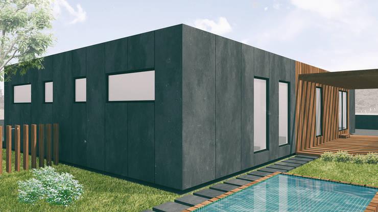 Alçado tardoz e piscina: Casas  por Estúdio AMATAM