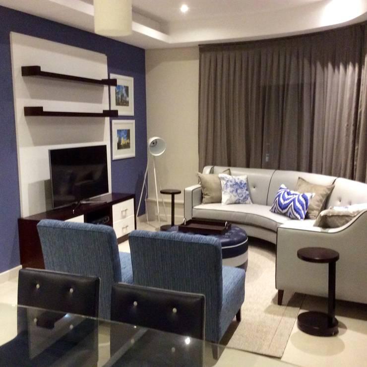 All custom made furniture.:  Living room by CS DESIGN