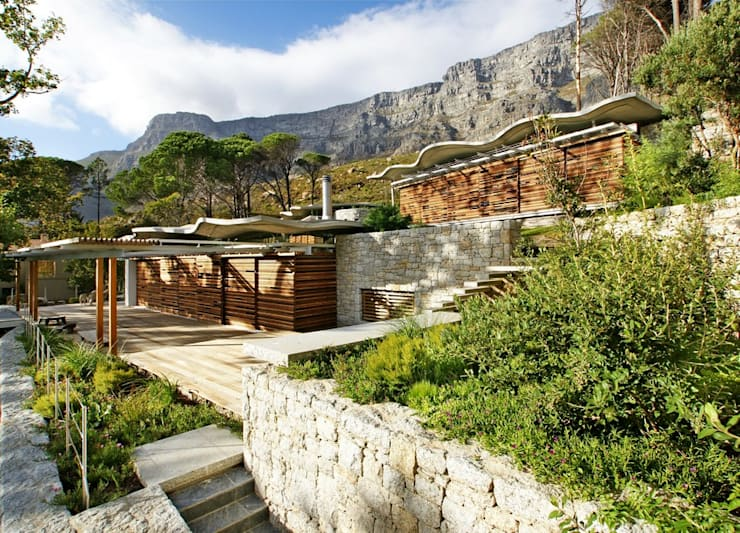 Garden & House Elevation:  Single family home by Van der Merwe Miszewski Architects