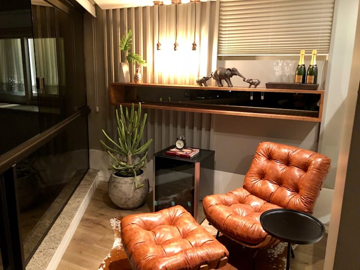 Poltrona costela : Salas de estar  por Natália de Bona Arquitetura
