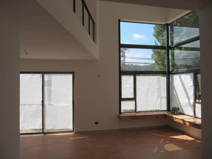 Casa Retiro: Livings de estilo moderno por Lau Arquitectos