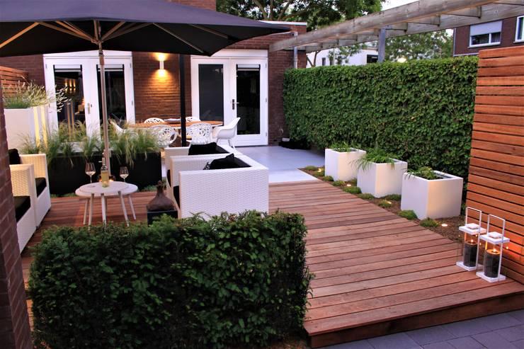 Ibiza tuin:  Tuin door Hoveniersbedrijf Guy Wolfs
