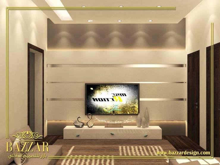 مجلس رجال:  Living room تنفيذ Bazzar Design