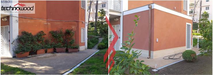 Maisons de style  par Technowood srl, Classique Bois Effet bois