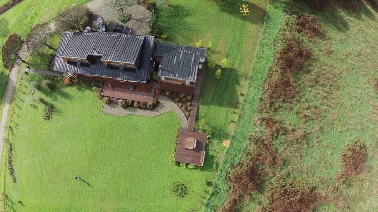 VISTA AEREA: Casas de estilo  por KOMMER ARQUITECTOS