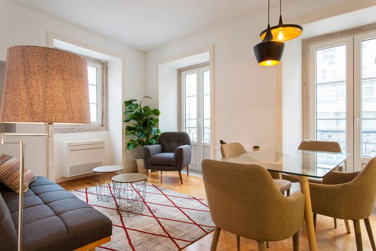 Sala Comum: Sala de estar  por Traço Magenta - Design de Interiores