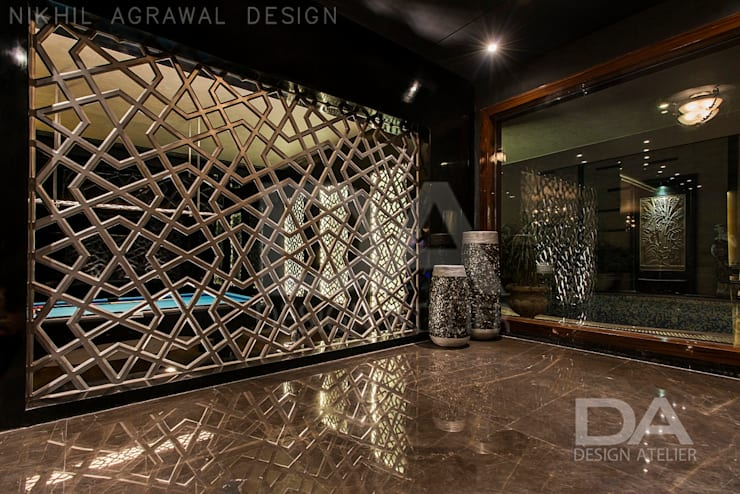 Hand Cut screen serving as an aesthetic partition:  Walls by Design Atelier