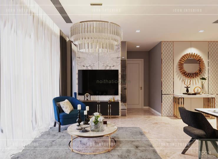 Sang trọng đẳng cấp với nội thất mạ Titan trong căn hộ Vinhomes Golden River:  Phòng khách by ICON INTERIOR