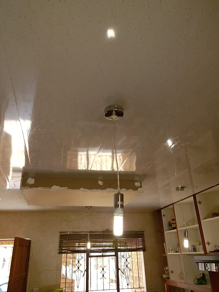 PVC Ceiling Instillation :  Kitchen by Kgodisho Solutions and Projects