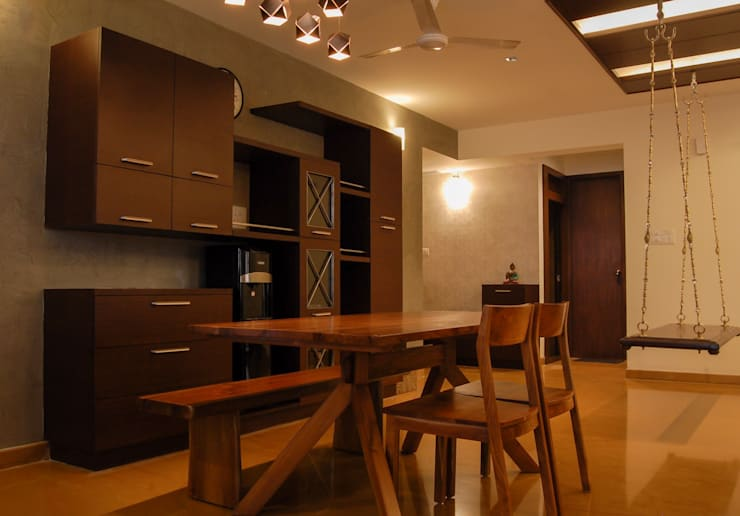 Dining room by Synergy Architecture and Interiors