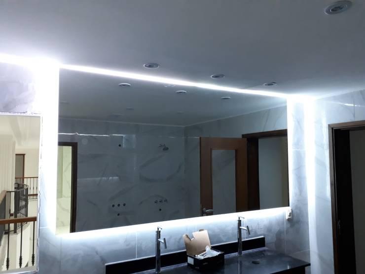 Revestimiento de Paredes: Baños de estilo  por M.i. arquitectura & construcción