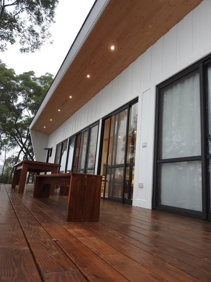 H. Villa:  庭院 by CPh ARCh