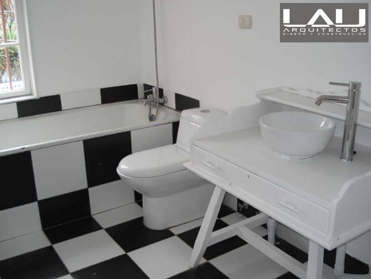 Baños de estilo  por Lau Arquitectos