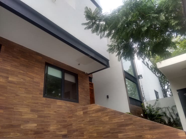 Casa Pulido:  de estilo  por D&E-ARQUITECTURA