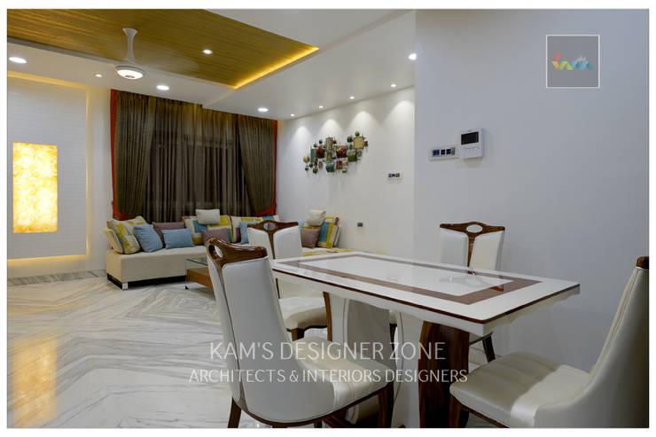 Dining Area:  Living room by KAM'S DESIGNER ZONE,Modern