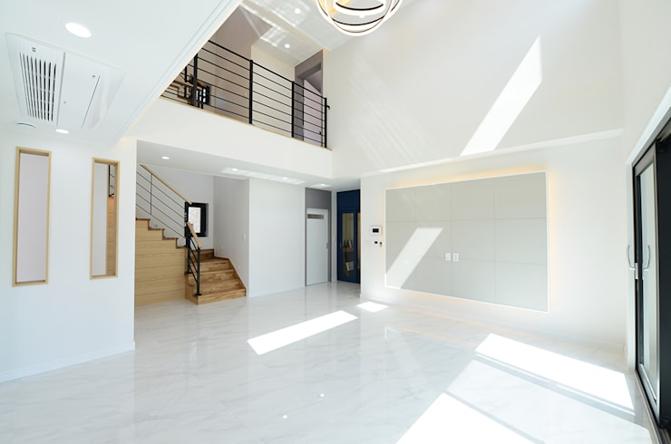 1층거실: 코원하우스의  거실
